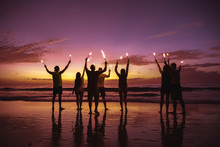 Big Group Friends With Sparkle Lights At Beach