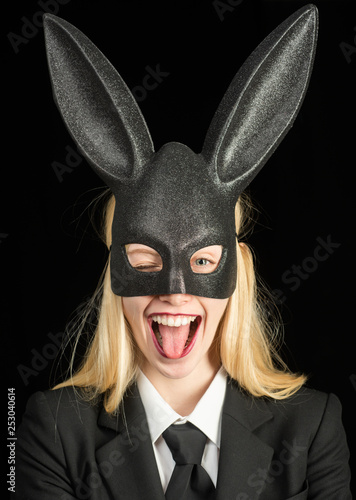 Photographie  Portrait of a happy woman in bunny ears winking