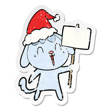 Cute Distressed Sticker Cartoon Of A Dog Wearing Santa Hat