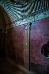 POMPEII, ITALY - 8 August 2015: Ruins of antique roman temple in Pompeii near volcano Vesuvius, Naples, Italy