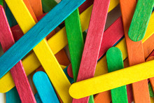 Colorful Scattered Wooden Multicolored Popsicle Sticks.