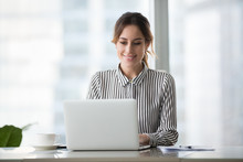 Happy Businesswoman Executive Working Online On Laptop At Office Desk