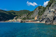 Italy, Cinque Terre, Monterosso, a large body of water with a mountain in the background