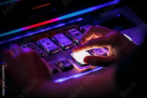 Macarons hand pushing button casino