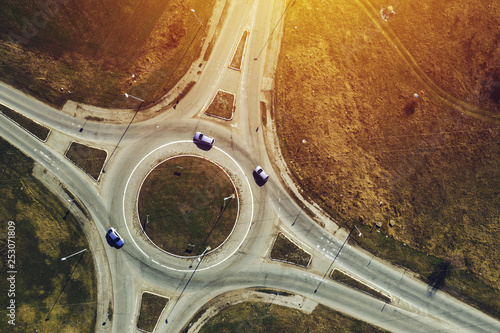 Obraz na plátně Aerial view of traffic circle roundabout road junction, top view