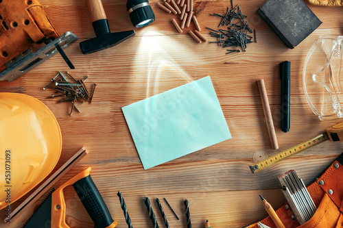 Poster Fleur Blank envelope mock up on carpentry woodwork workshop desk