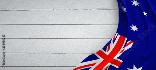 Fotografie, Obraz Australia flag, on top of white wood. Wrinkled fabric.