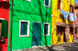 Leinwanddruck Bild - Exterior of colorful houses of Burano Island in Venice