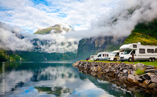 Foto auf Acrylglas Weiß Campervan RV vehicles at norwegian camping by a fjord