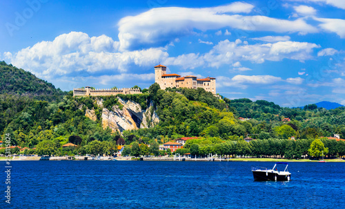 Fotografie, Obraz  Picturesque lake Lago Maggiore, view of Rocca di Angera castle