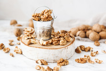 A Bucket Of Walnuts On A Marbl...