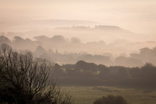 Morning Mist In Valley Over Fields And Beyond