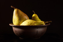 Pears In A Clay Bowl With Water Drops