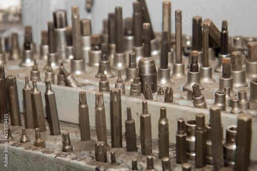 Foto op Canvas Begraafplaats Lot of screwdriver heads