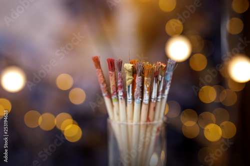 Fotografie, Obraz  A set of brushes with remnants of paint. Blurred background