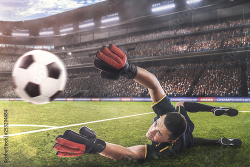Fotografía goalkeeper jumping for the ball on football match