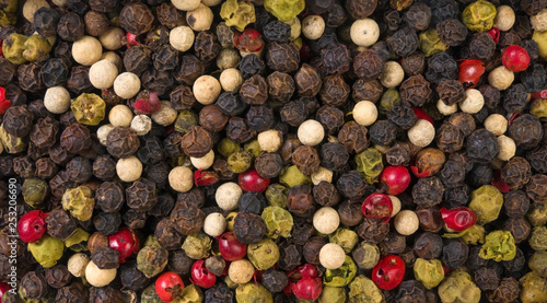 Keuken foto achterwand Macrofotografie colored pepper peppercorns background. Natural seasoning texture. Natural spices and food ingredients.