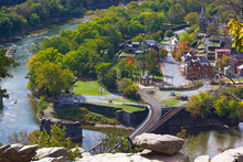 A View On Railroad Bridge Across The River At Harpers Ferry National Historic Park And Town. Early Autumn Signs In West Virginia Park Landscape.
