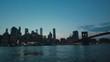 Pan from Brooklyn bridge to a Panorama of New York in Twilight