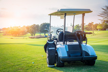 Golf Cart Park On Green Grass In Golf Course ,beautiful View Of Golf Course And Sun Sky Background