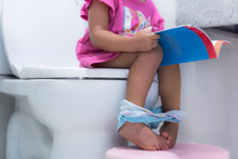Toddler Sitting On The Toilet ...
