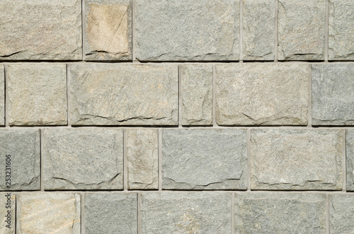 Fotografie, Obraz  Sliced gneiss cladding slabs on wall close up