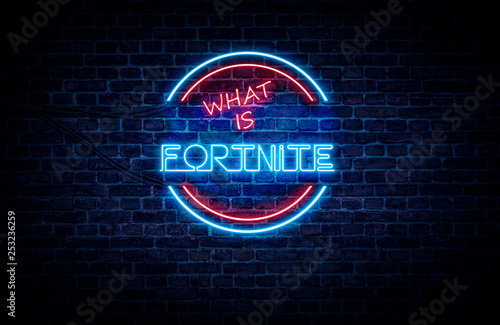 Photo  A neon sign in blue and red light on a brick wall background that reads: WHAT IS FORTNITE