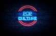 A neon sign in blue and red light on a brick wall background that reads: POP CULTURE