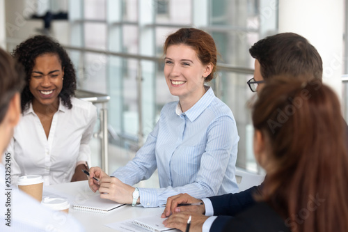 Fotografía  Multiracial business people take a break during negotiations joking laughing