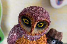 Artificial Owl With Bright Yellow Eyes. Wooden Owl Painted With Bright Colors