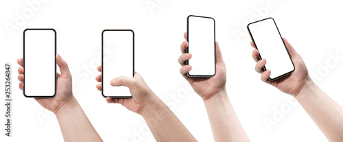 Foto  Set of four smartphones, blank screen and isolated on white background