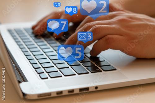 Obraz Man is using laptop with black keys, Social media and social networking. Marketing concept - fototapety do salonu