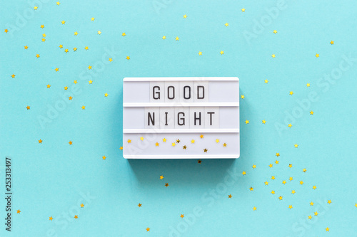Pinturas sobre lienzo  Lightbox text Good Night and gold star on blue paper background