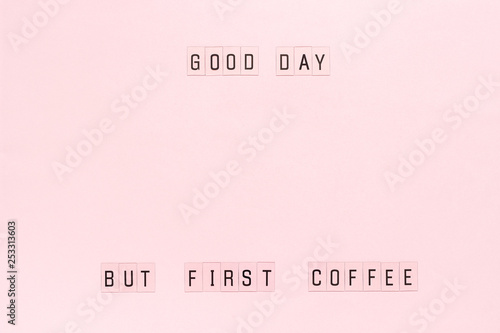 Text Good day, but first coffee on pastel pink paper background. Layout Top view Template for postcard or your design