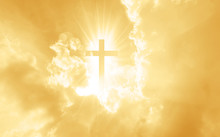 Christian Cross Appears Bright In The Yellow Sky