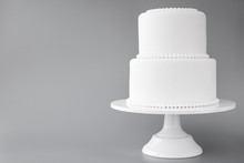 White Wedding Cake Blank On A Gray Background. Simple Minimalism.