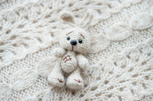 Knitted White Hare Is Lying On...