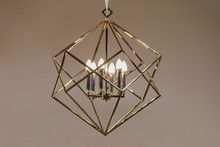 Polygonal Chandelier, Gold, Brass, Different Shapes Of A Triangle, Inside Lamp There Are Candles. Fashion Design Chandeliers