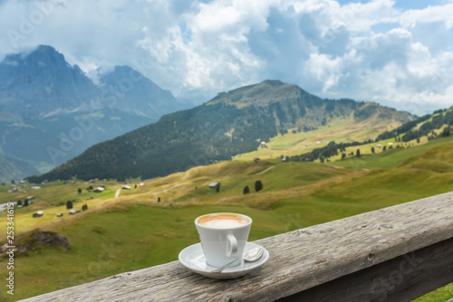 Coffee cup in coffee time on mountain view background, Dolotites, Italy
