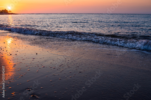 Beautiful cloudscape over the sea, sunset shot.majestic sunset over sea shore. romantic evening on the beach.freedom and inspiration over the ocean.waves on beach at sunset time , sunlight reflect on