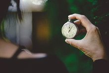 Woman Holding An Old Chronometer