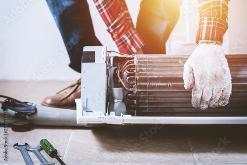 repairing the air conditioner Canvas Print