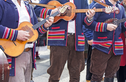 Traditional Croatian musicians in Slavonian costumes play in the city square - 253355205