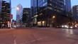 Cinematic time lapse of a modern city intersection at night.