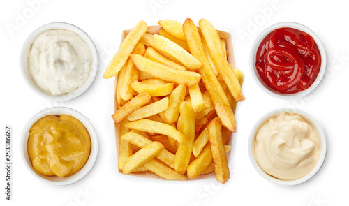 Fotografia French fries with ketchup, mayonnaise, mustard, garlic sauce top view isolated o