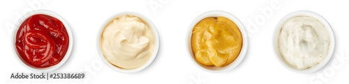 Fotografía  Ketchup, mayonnaise, mustard, garlic sauce top view isolated on white background