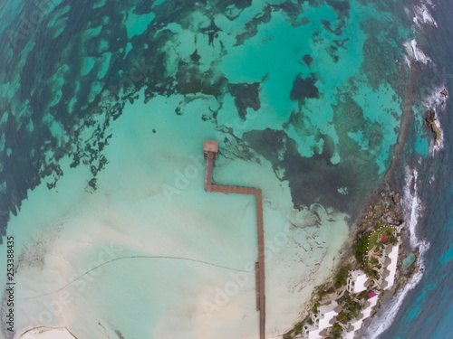 Fotografie, Obraz  Aerial view on Crystal clear turquoise water of Caribbean Sea and Coast of Isla