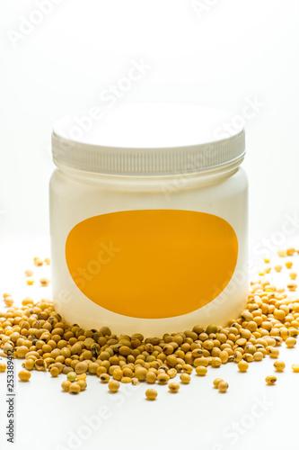 Fényképezés Light yellow powder and can. Soya lecithin powder