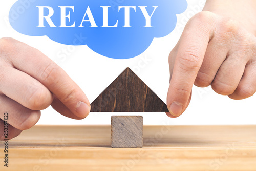Fototapety, obrazy: Real estate concept. Wooden house model on wooden table, white background