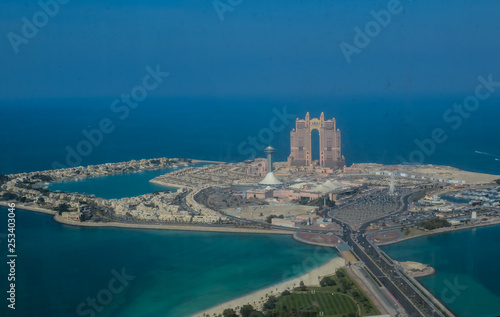 Carta da parati Bird's eye and aerial drone view of Abu Dhabi city from observation deck
